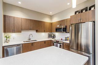 Photo 1: 202 10 Auburn Bay Link SE in Calgary: Auburn Bay Apartment for sale : MLS®# A1128841