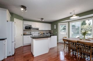 Photo 8: 85 STRATHRIDGE Close SW in Calgary: Strathcona Park Detached for sale : MLS®# A1019965