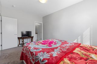 Photo 17: 903 Redstone Crescent NE in Calgary: Redstone Row/Townhouse for sale : MLS®# A1096519