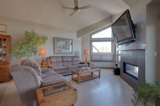 Photo 5: 40 Cougar Ridge Landing SW in Calgary: Cougar Ridge Row/Townhouse for sale : MLS®# A1148928