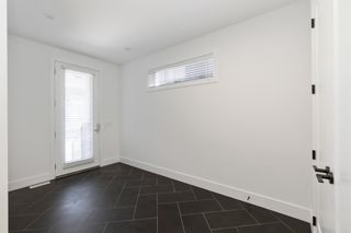 Photo 3: 7853 8a Avenue SW in Calgary: West Springs Detached for sale : MLS®# A1120136