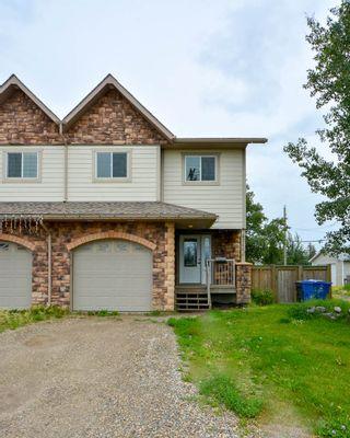 Photo 1: 9711 86 Street in Fort St. John: Fort St. John - City SE 1/2 Duplex for sale (Fort St. John (Zone 60))  : MLS®# R2390740
