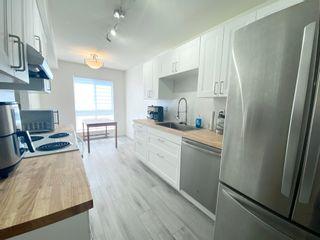 Photo 4: 202 14981 101A Avenue in Surrey: Guildford Condo for sale (North Surrey)  : MLS®# R2606277