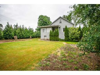 Photo 1: 4093 216 Street in Langley: Murrayville House for sale : MLS®# R2574448