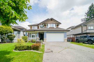 """Photo 1: 7310 146 Street in Surrey: East Newton House for sale in """"CHIMNEY HEIGHTS"""" : MLS®# R2465125"""