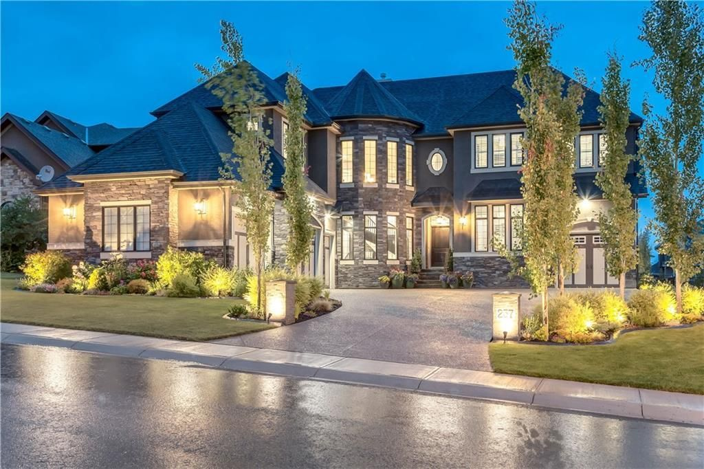 French Country style custom home built by BAYWEST with 4 attached garages.