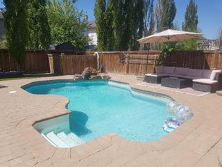 Photo 1: 48 Cranfield Manor SE in Calgary: Cranston Detached for sale : MLS®# A1153588