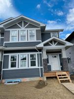 Main Photo: 665 Lewis Greens Drive NW in Edmonton: Zone 58 House Half Duplex for sale : MLS®# E4239436