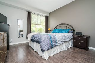 "Photo 11: 104 2110 ROWLAND Street in Port Coquitlam: Central Pt Coquitlam Townhouse for sale in ""AVIVA ON THE PARK"" : MLS®# R2168071"