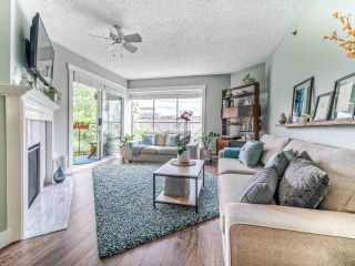 "Photo 1: 208 910 W 8TH Avenue in Vancouver: Fairview VW Condo for sale in ""The Rhapsody"" (Vancouver West)  : MLS®# R2487945"