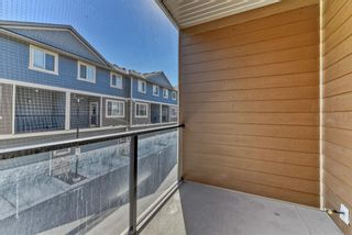 Photo 9: 539 Panatella Walk NW in Calgary: Panorama Hills Row/Townhouse for sale : MLS®# A1125854