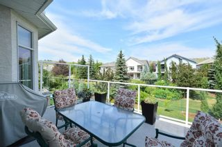 Photo 47: 104 GLENEAGLES Landing: Cochrane House for sale : MLS®# C4127159