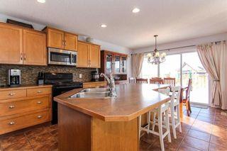 Photo 5: 944 CRANSTON Drive SE in Calgary: Cranston House for sale : MLS®# C4145156