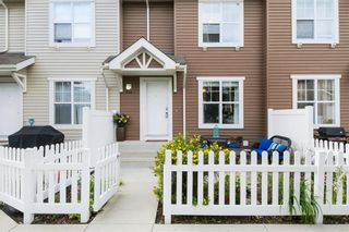 Photo 2: 206 TOSCANA Gardens NW in Calgary: Tuscany Row/Townhouse for sale : MLS®# A1088865