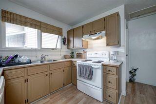 Photo 10: 14703 Deer Ridge Drive SE in Calgary: Deer Ridge Detached for sale : MLS®# A1126639