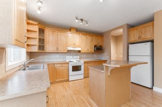 Photo 7: 7 39 Strathlea Common SW in Calgary: Strathcona Park Semi Detached for sale : MLS®# A1056254