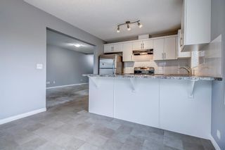 Photo 13: 129 Windstone Park SW: Airdrie Row/Townhouse for sale : MLS®# A1137155