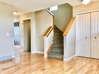 Photo 8: 166 Hidden Hills Road NW in Calgary: Hidden Valley Detached for sale : MLS®# A1102376