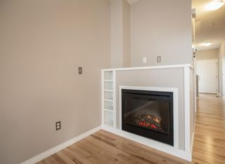 Photo 6: 8 Everridge Gardens SW in Calgary: Evergreen Row/Townhouse for sale : MLS®# A1041120