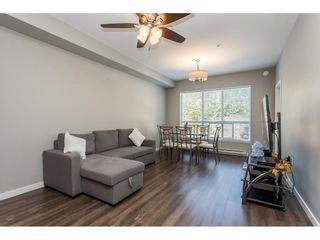 """Photo 7: 210 6490 194 Street in Surrey: Clayton Condo for sale in """"WATERSTONE ESPLANADE GRANDE"""" (Cloverdale)  : MLS®# R2603405"""