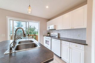Photo 11: 107 Tuscany Valley Drive Drive in Calgary: Tuscany Detached for sale : MLS®# A1135178