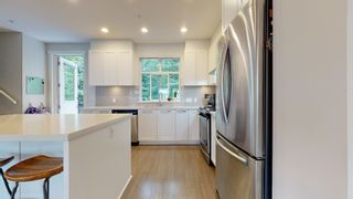 """Photo 2: 37 39548 LOGGERS Lane in Squamish: Brennan Center Townhouse for sale in """"Seven Peaks"""" : MLS®# R2612881"""