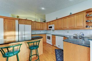 Photo 7: 14 6841 Coach Hill Road SW in Calgary: Coach Hill Residential for sale : MLS®# A1059348