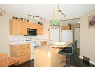 Photo 11: 1 122 BOW RIDGE Crescent: Cochrane House for sale : MLS®# C4073392