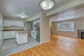 Photo 11: 231 Regal Park NE in Calgary: Renfrew Row/Townhouse for sale : MLS®# A1068574