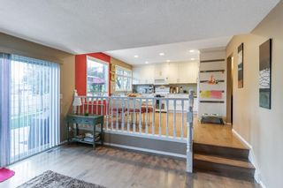Photo 6: 143 Silver Brook Road NW in Calgary: Silver Springs Detached for sale : MLS®# A1141284