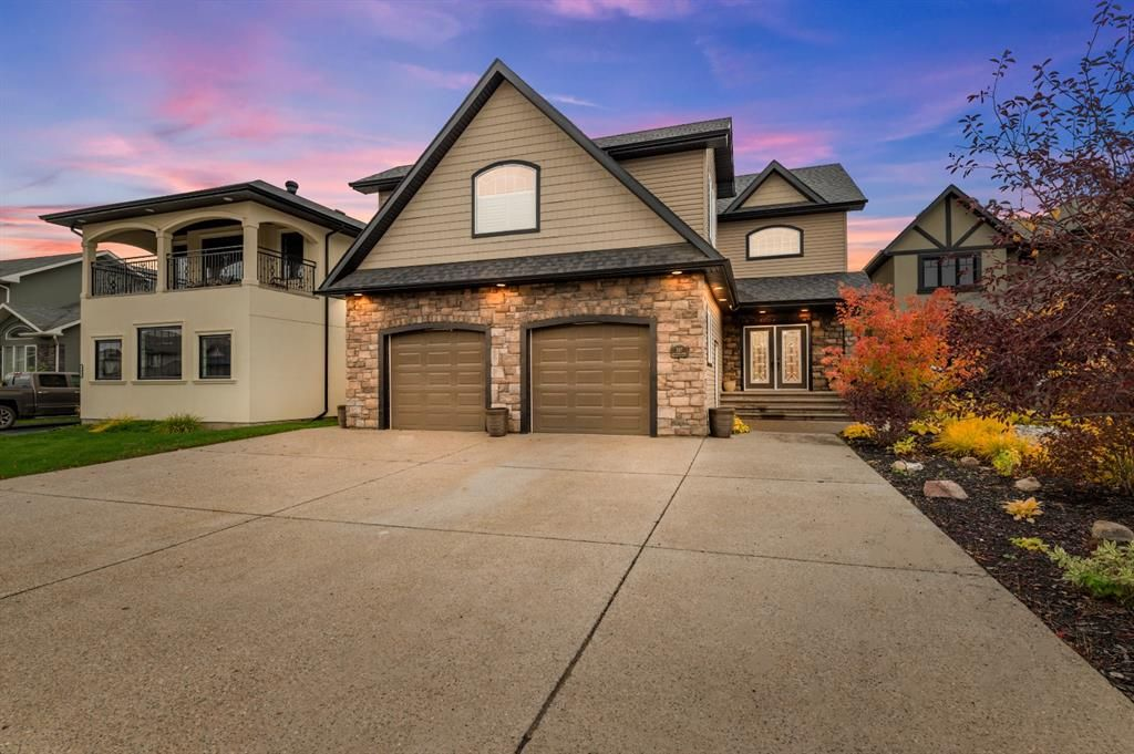 Luxurious 3,234sqft home with 4-car driveway backing onto pond.