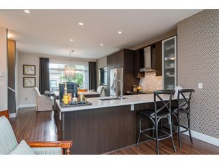 """Photo 4: 62 9989 BARNSTON Drive in Surrey: Fraser Heights Townhouse for sale in """"HIGHCREST"""" (North Surrey)  : MLS®# R2471184"""
