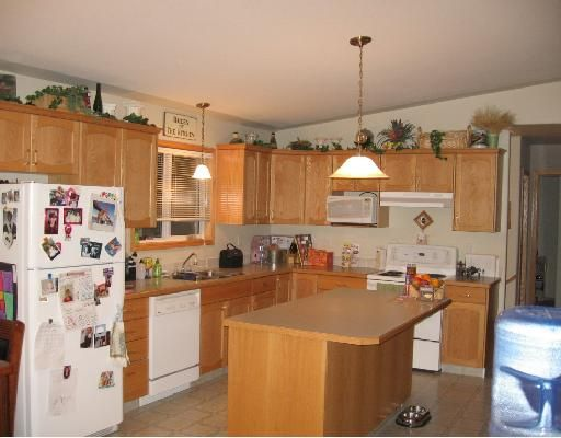 """Photo 3: Photos: 4605 BARBER Court in Fort_Nelson: Fort Nelson -Town House for sale in """"MIDTOWN"""" (Fort Nelson (Zone 64))  : MLS®# N188678"""