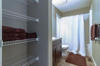 Photo 10: 306 FIRESIDE Place: Cochrane House for sale : MLS®# C4137461