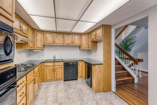 Photo 13: 10 Coach  Manor Rise SW in Calgary: Coach Hill Row/Townhouse for sale : MLS®# A1077472