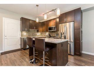"""Photo 6: 210 6490 194 Street in Surrey: Clayton Condo for sale in """"WATERSTONE ESPLANADE GRANDE"""" (Cloverdale)  : MLS®# R2603405"""