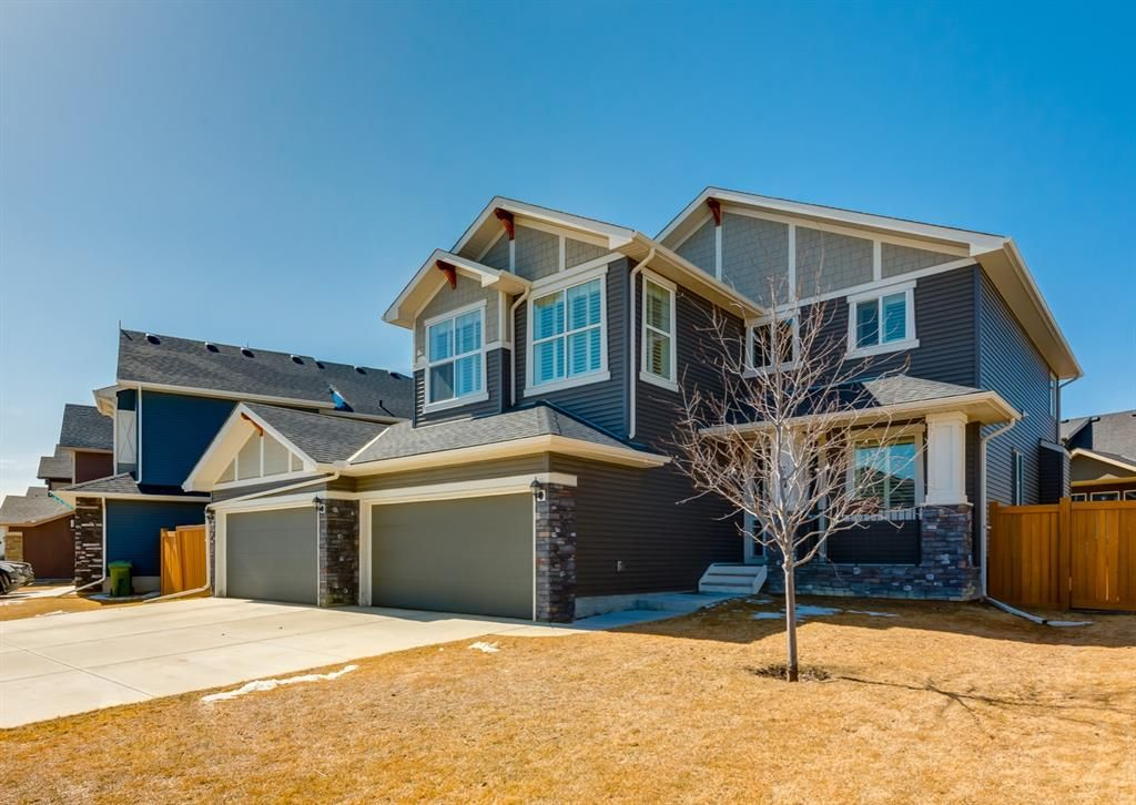 Fabulous lot, great location with lots of upgrades inside and a QUAD garage!
