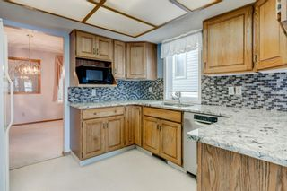 Photo 7: 113 Shawnee Rise SW in Calgary: Shawnee Slopes Semi Detached for sale : MLS®# A1068673