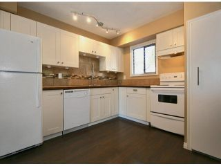 """Photo 1: 63 6645 138TH Street in Surrey: East Newton Townhouse for sale in """"HYLAND CREEK ESTATES"""" : MLS®# F1402091"""
