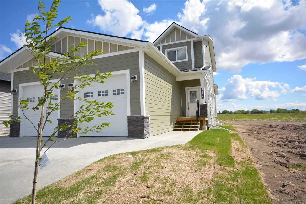Main Photo: 8203 79A Street in Fort St. John: Fort St. John - City SE 1/2 Duplex for sale (Fort St. John (Zone 60))  : MLS®# R2487647