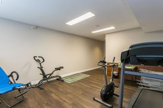 """Photo 36: 107 5909 177B Street in Surrey: Cloverdale BC Condo for sale in """"Carridge Court"""" (Cloverdale)  : MLS®# R2602969"""