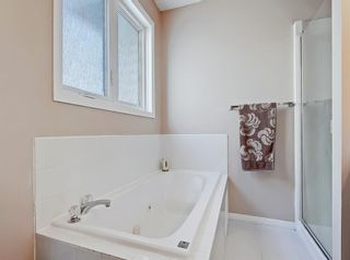 Photo 15: 119 Prominence Heights SW in Calgary: Patterson Row/Townhouse for sale : MLS®# A1070136