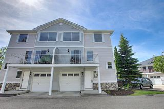Main Photo: 619 Country Village Cape NE in Calgary: Country Hills Village Row/Townhouse for sale : MLS®# A1117640