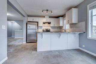 Photo 12: 129 Windstone Park SW: Airdrie Row/Townhouse for sale : MLS®# A1137155