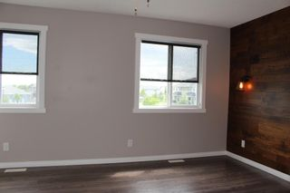 Photo 29: 1404 Clover Link: Carstairs Row/Townhouse for sale : MLS®# A1073804