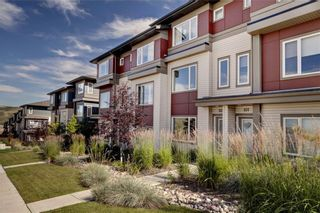 Photo 2: 102 501 RIVER HEIGHTS Drive: Cochrane Row/Townhouse for sale : MLS®# C4266118