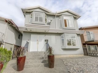 Photo 1: 1125 East 61st Avenue in Vancouver: South Vancouver Home for sale ()  : MLS®# R2002143