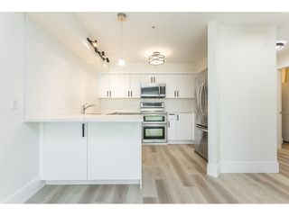 """Photo 12: 102 1955 SUFFOLK Avenue in Port Coquitlam: Glenwood PQ Condo for sale in """"OXFORD PLACE"""" : MLS®# R2608903"""