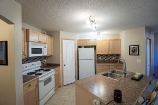 Photo 11: 104 3 EVERRIDGE Square SW in Calgary: Evergreen Row/Townhouse for sale : MLS®# A1143635