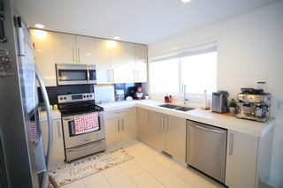 Photo 12: 104 1530 Bayside Avenue SW: Airdrie Row/Townhouse for sale : MLS®# A1147383